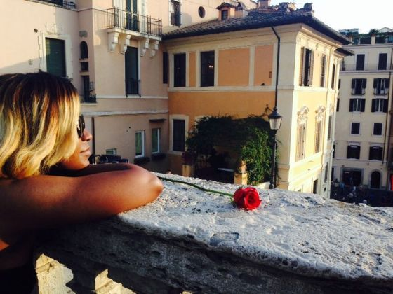 Regine taking in a beautiful sunset at The Spanish steps
