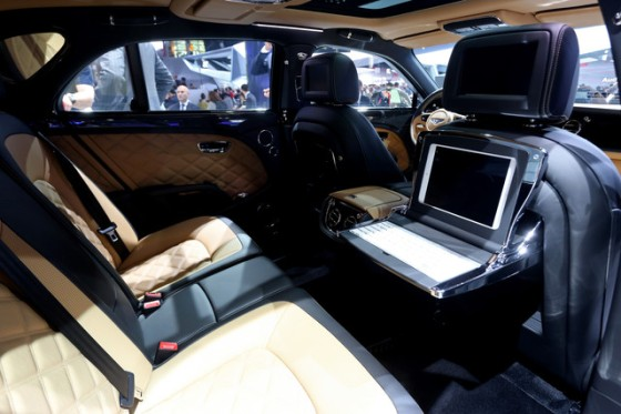 The interior fittings of the rear passenger seats of a luxury Bentley Mulsanne Speed.