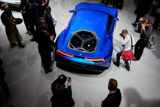 """The Asterion is the company's first ever plug-in vehicle. The vibrant blue Lamborghini concept car glided soundlessly onto a stage at the Paris Motor Show under electric power. The supercar, which combines three electric motors with a V10 engine for a total of 910 horsepower, can be switched between pure electric and the traditional combustion power."" - BLOOMBERG"