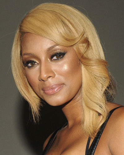 Or you can do it like Keri Hilson. Blonde is always fun for the summer and a long bob like this one gives you tons of styling options.