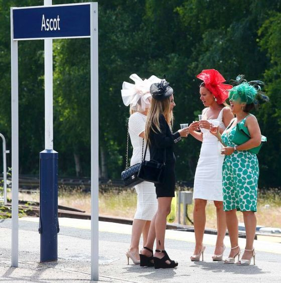 Race-goers-enjoy-a-drink-on-the-platform-of-the-railway-station