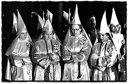 Woman of the Klan bow their heads in prayer at a rally near Salisbury, North Carolina, 1965